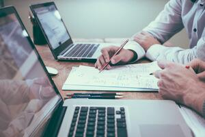 Two users auditing their manage services provider