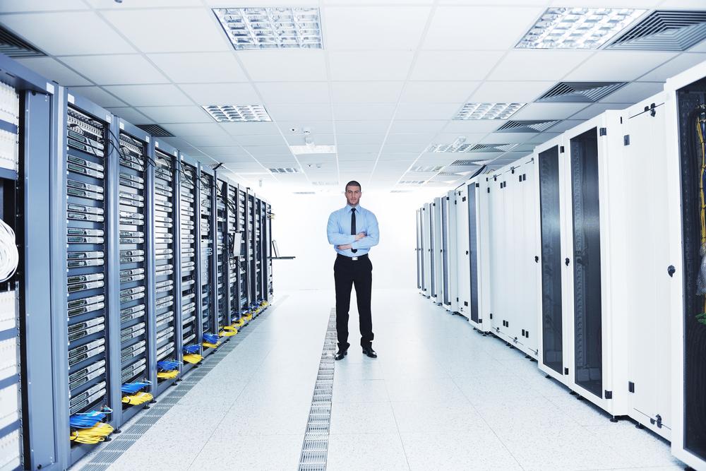 young handsome business man  engeneer in datacenter server room-3